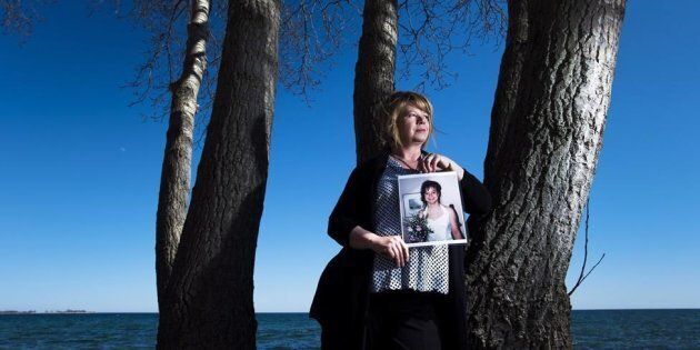 Donna May holds a photograph of her late daughter Jacey, a victim of the opioid crisis, in Toronto on...