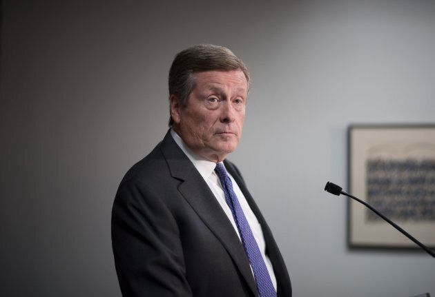 Toronto mayor John Tory speaks at a press conference at city hall after the Ontario Superior Court ruled...