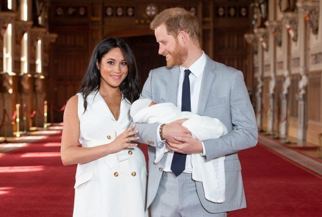 Meghan Markle, Duchess of Sussex and Prince Harry, Duke of Sussex, pose for a photo with their newborn...