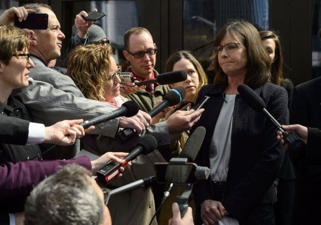 Crown Prosecutor Barbara Mercier talks to reporters as she leaves court in Ottawa following a decision on Vice-Admiral Mark Norman on May 8, 2019.