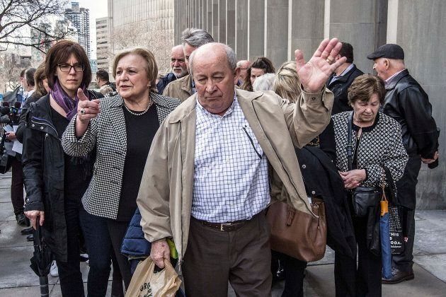 The parents of Dr. Elana Fric, followed by friends and family of the murdered family doctor, leave Superior...