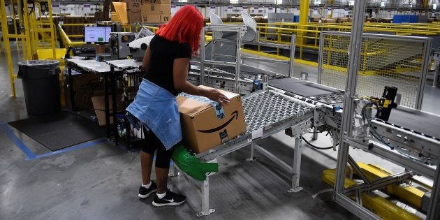 A worker at an Amazon fulfillment centre in Baltimore, Md., April 30,