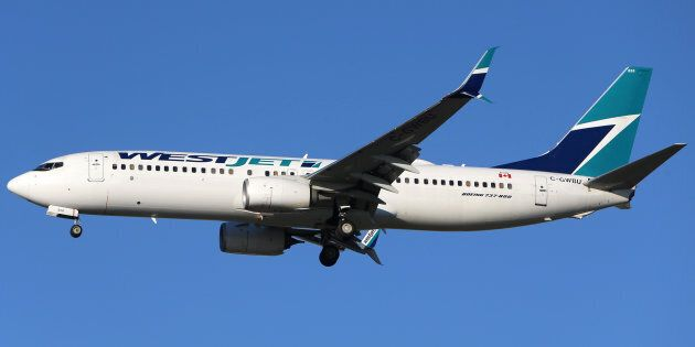 A WestJet Boeing 737-800 airplane is seen here flying over British Columbia on Feb. 5, 2019. A new deal...
