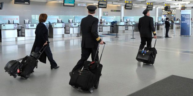 A flight crew is seen here walking through Terminal 1 at Toronto Pearson International Airport in April...