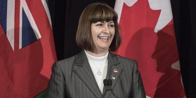 Marie-France Lalonde smiles during a news conference at the Queens Park on Nov. 1,
