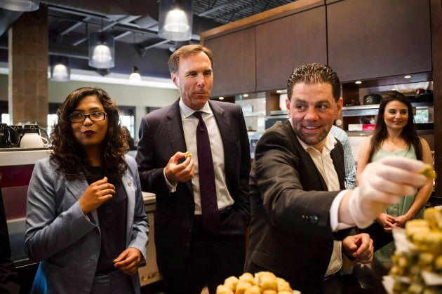 CEO of Paramount Fine Foods, Mohamad Fakih (right) gives Finance Minister Bill Morneau a tour of his...