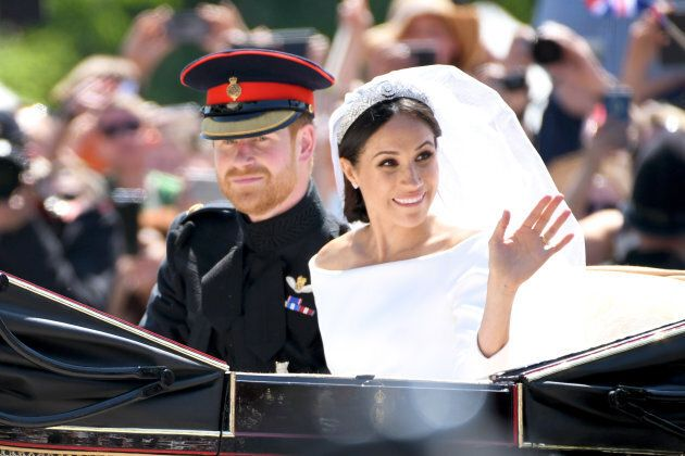 The Duke and Duchess of Sussex leave Windsor Castle in the Ascot Landau carriage during a procession...