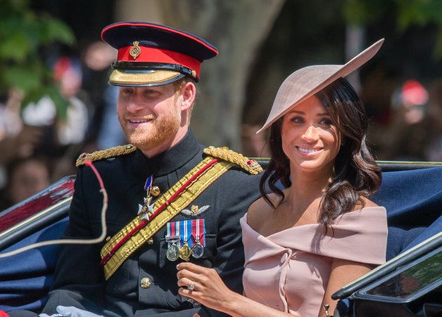 The Duke and Duchess of Sussex ride by carriage during Trooping The Colour 2018 on June 9 in