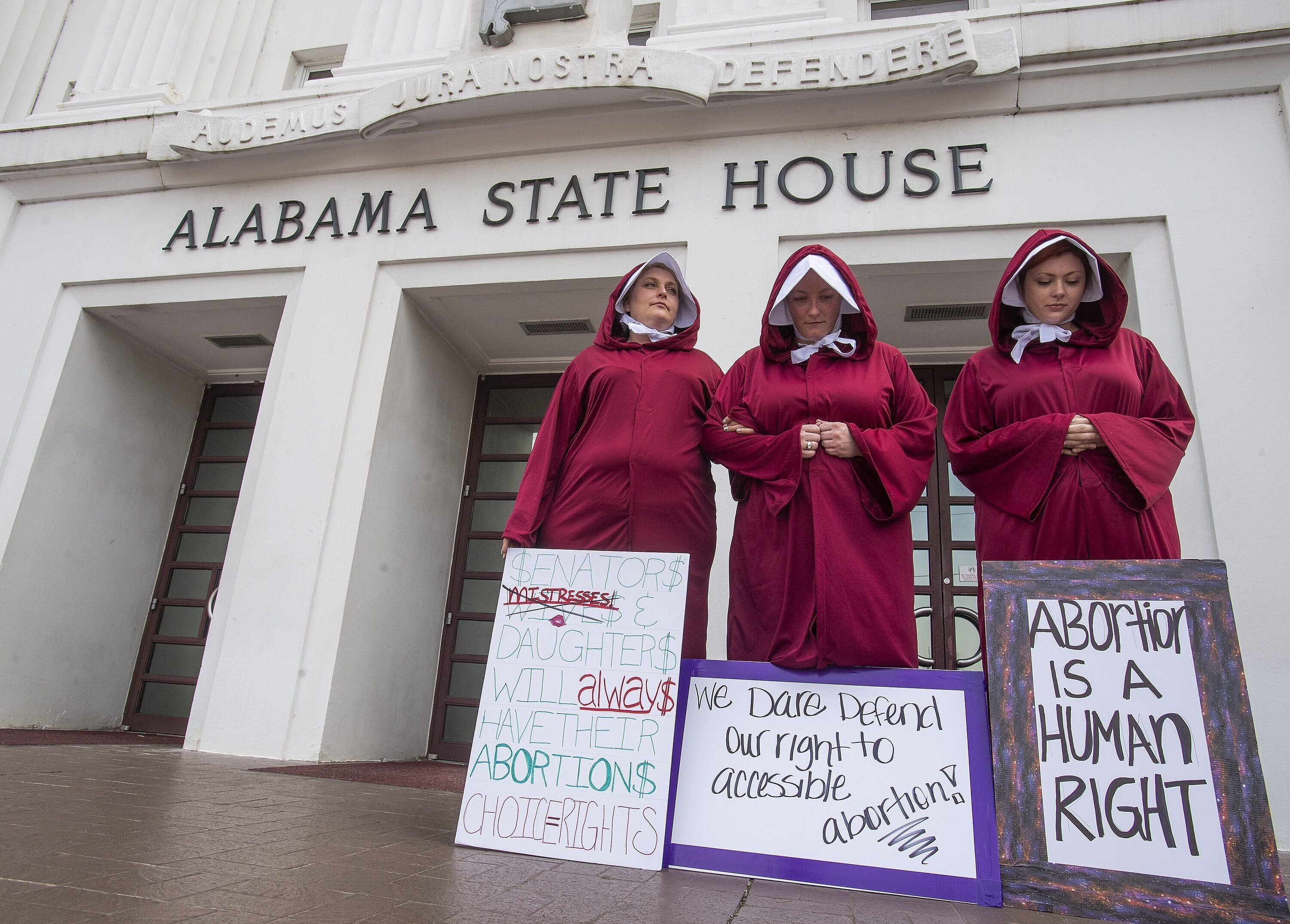 Bianca Cameron-Schwiesow, from left,Kari Crowe and Margeaux Hardline, dressed as handmaids, take part in a protest against HB314, known as the abortion ban bill, at the Alabama Statehouse in Montgomery, Ala., on Wednesday April 17, 2019. Protest04 (Photo by Mickey Welsh / Advertiser/USA Today Network/Sipa USA)