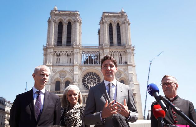 Prime Minister Justin Trudeau speaks with reporters after visiting Notre Dame cathedral with...