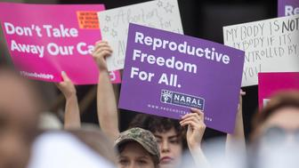 REMOVES ANTI ABORTION REFERENCE - Protestors rally outside of the Georgia State Capitol following the signing of HB 481, in Atlanta, Tuesday, May 7, 2019. Georgia Governor Brian Kemp signed legislation on Tuesday banning abortions once a fetal heartbeat can be detected. (Alyssa Pointer/Atlanta Journal-Constitution via AP)