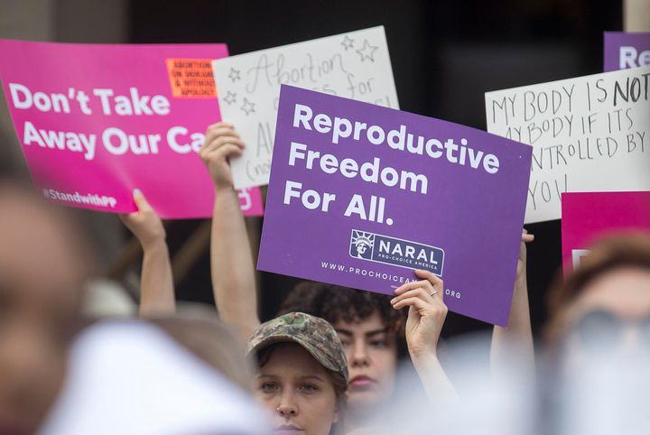 Protesters rally outside of the Georgia State Capitol following the signing of Georgia's bill restricting abortions on May 7,