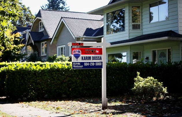 A real estate for sale sign is pictured in front of a home in Vancouver, B.C., Sept. 22,
