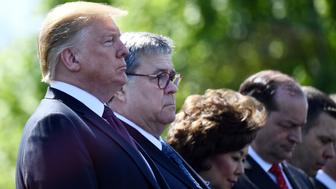 (L-R) US President Donald Trump, Attorney General William Barr, Transportation Secretary Elaine Chao, Secretary of Labor Alex Acosta and Acting Secretary of Homeland Security Kevin McAleenan attend the 38th Annual National Peace Officers Memorial Service on May 15, 2019, in Washington, DC. (Photo by Brendan Smialowski / AFP)        (Photo credit should read BRENDAN SMIALOWSKI/AFP/Getty Images)