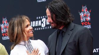 Actors  Halle Berry (L) and Keanu Reeves attend a handprint ceremony honoring Keanu Reeves at the TCL Chinese Theatre IMAX forecourt on May 14, 2019 in Hollywood, California. (Photo by VALERIE MACON / AFP)        (Photo credit should read VALERIE MACON/AFP/Getty Images)