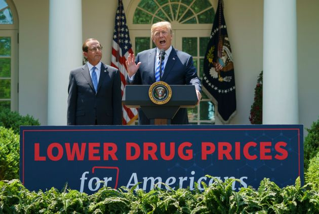Trump, right, speaks at an event about lowering prescription drug prices. His patent office chief's speech...