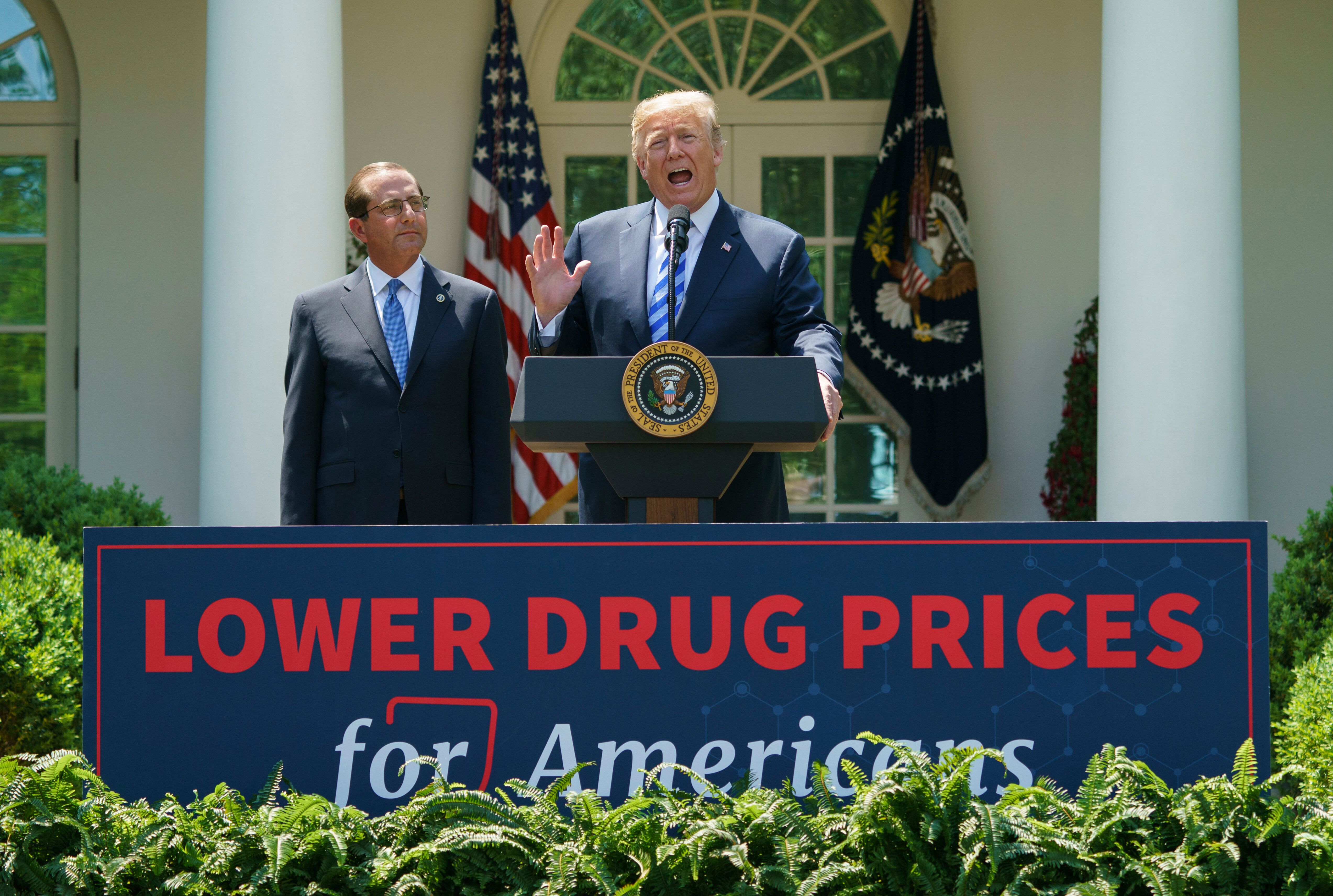Trump, right, speaks at an event about lowering prescription drug prices. His patent office chief's speech at a fundraiser ba