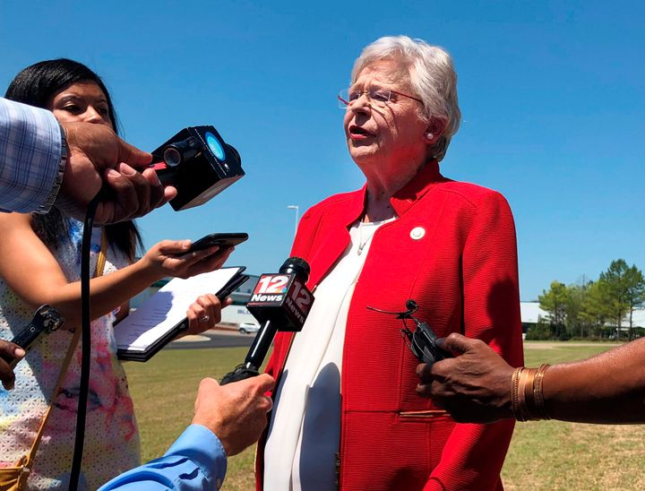 Alabama Gov. Kay Ivey (R) discusses a bill that would virtually outlaw abortion in the state while visiting a car factory at