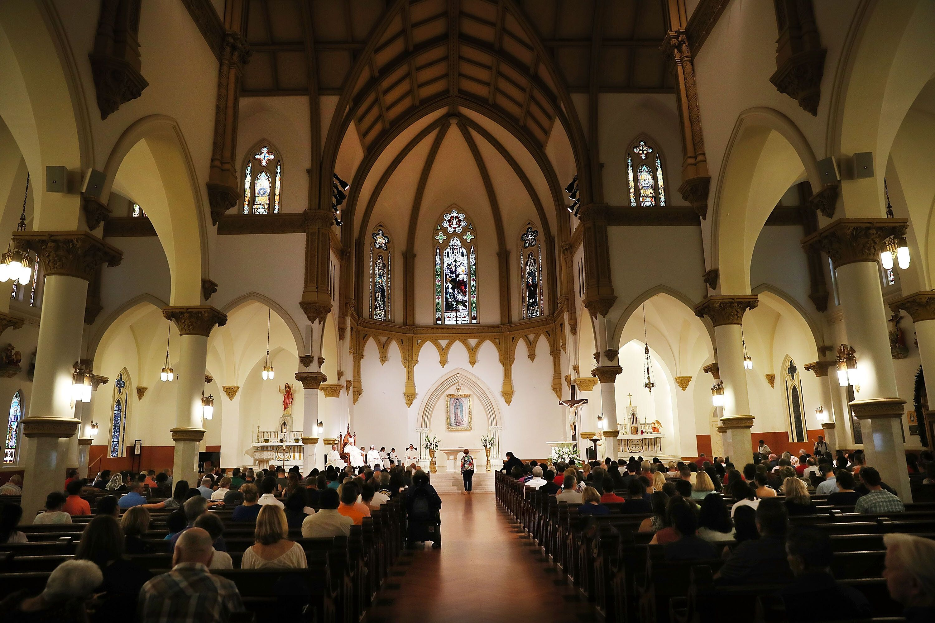 People attend a Mass at the Cathedral Shrine of the Virgin of Guadalupe, the mother church of the Roman Catholic Diocese of D
