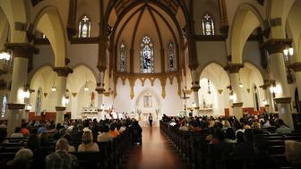 DALLAS, TX - JULY 09:  People attend a Mass for Hope and Healing at Cathedral Shrine of the Virgin of Guadalupe on July 9, 2016 in Dallas, Texas. Five police officers were killed and seven others were injured in the evening ambush during a march against recent police involved shootings. Investigators are saying the suspect is 25-year-old Micah Xavier Johnson of Mesquite, Texas. This is the deadliest incident for U.S. law enforcement since September 11.  (Photo by Spencer Platt/Getty Images)