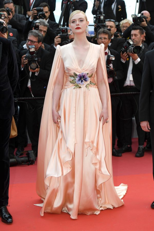"The actress and festival jury member wears a Gucci gown for the festival's opening ceremony and ""The Dead Don't Die"" screenin"