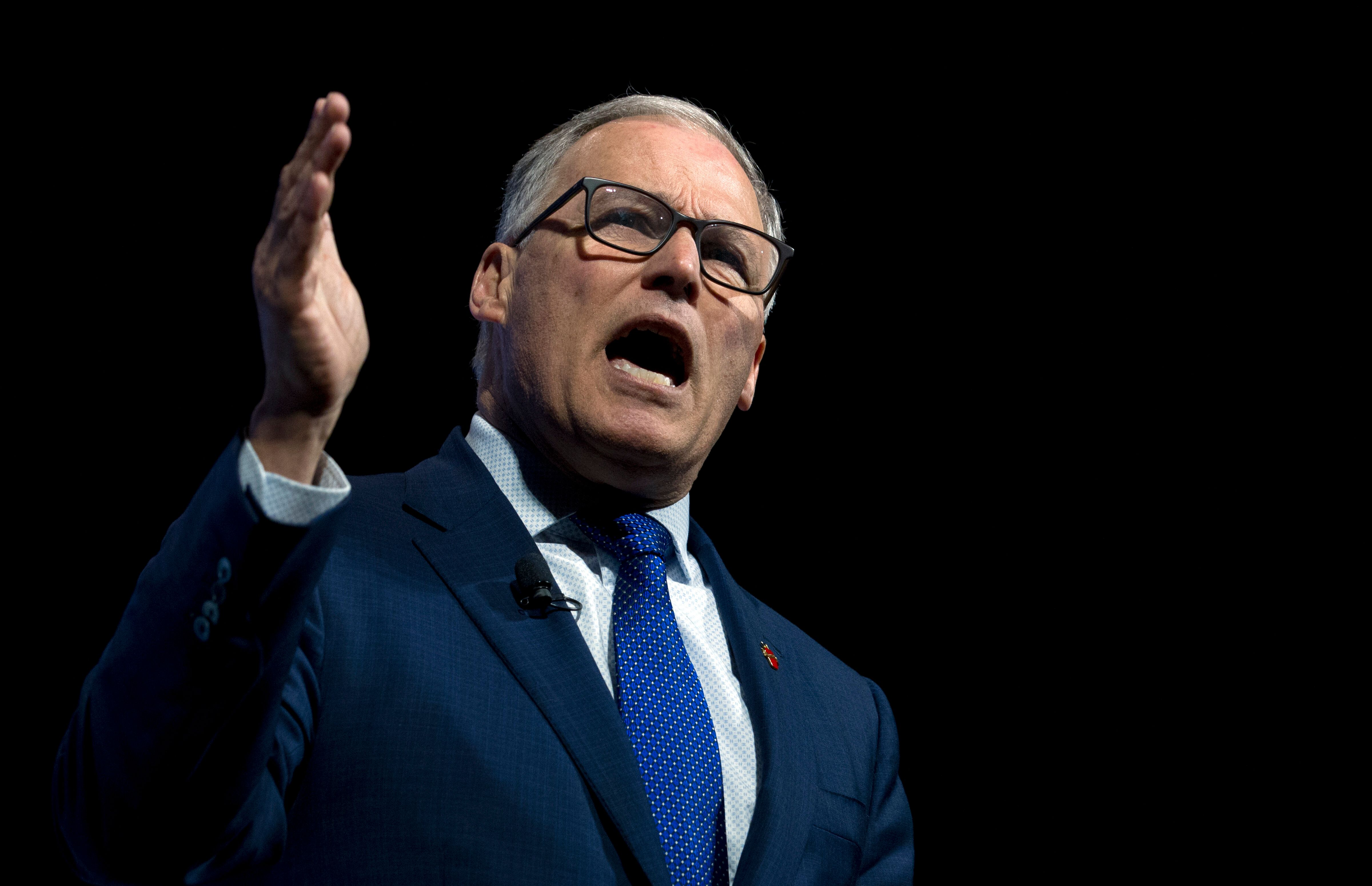 Democratic presidential candidate Washington Gov. Jay Inslee, speaks during the We the People Membership Summit, featuring the 2020 Democratic presidential candidates, at the Warner Theater, in Washington, Monday, April 1, 2019. (AP Photo/Jose Luis Magana)