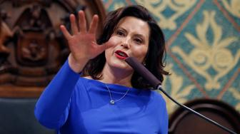 "FILE - Ion this Feb. 12, 2019 file photo, Michigan Gov. Gretchen Whitmer delivers her State of the State address to a joint session of the House and Senate at the state Capitol in Lansing, Mich. Whitmer wants to spend billions more to fix the roads and boost a lagging education system. But as the Democrat prepares to deliver her first budget proposal to the Republican-led Legislature, she faces fiscal and political pressures that are complicating her task. She notes the general fund has not grown much. The budget is Whitmer's chance to detail how she plans to ""fix the damn roads"" and pay for priorities like letting high school graduates attend community college for free. (AP Photo/Al Goldis, File)"