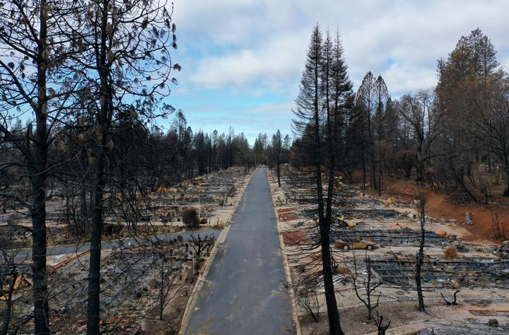 An aerial view of homes destroyed by the Camp Fire on February 11, 2019 in Paradise, California. Three months after the deadl