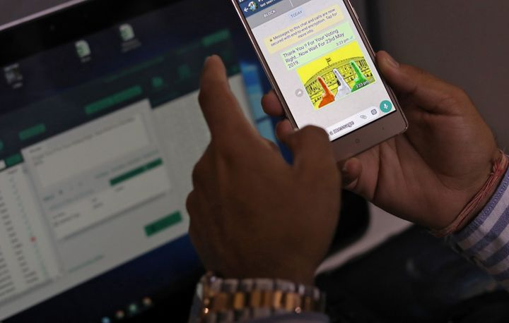 Rohitash Repswal, a digital marketer, checks a WhatsApp message that he sent using a software tool that appears to automate the process of sending messages to WhatsApp users, inside his office in New Delhi, India, May 8, 2019.