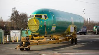 The body of a Boeing 737 MAX airplane is pictured at the Boeing Renton Factory in Renton, Washington on March 27, 2019. - Embattled aviation giant Boeing will do all it can to prevent future crashes like the two that killed nearly 350 people in recent months, a company official said. Boeing gathered hundreds of pilots and reporters at its factory to unveil a fix to the flight software of its grounded 737 MAX aircraft, which has been implicated in the latest air disasters. (Photo by Jason Redmond / AFP)        (Photo credit should read JASON REDMOND/AFP/Getty Images)