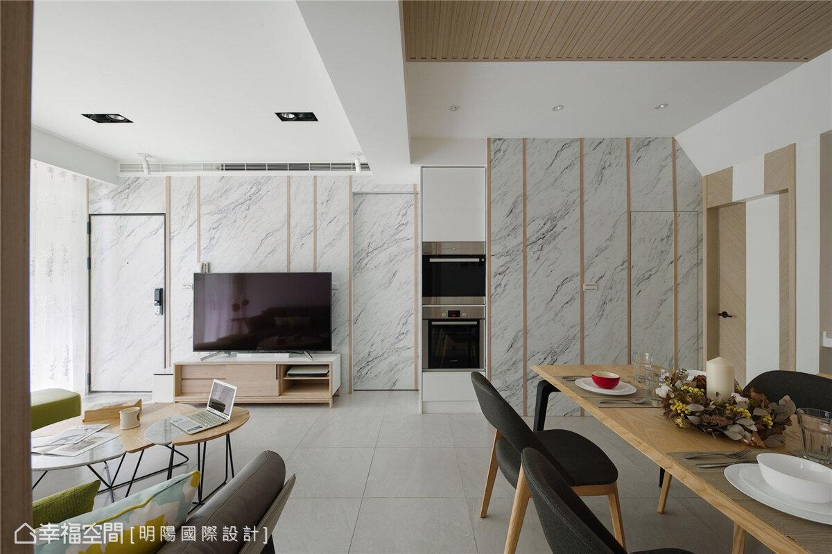 ▲少了隔間牆,開放空間同樣可以保有整齊與對襯,透過相同的牆面設計,讓風格調性完整而一致。