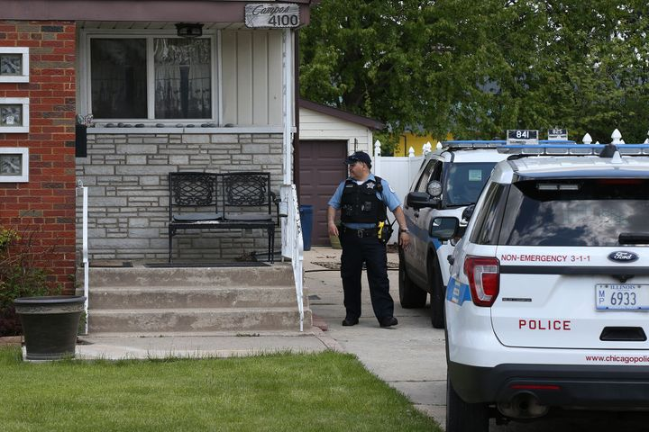 Chicago police watch over a home on Wednesday, May 15, 2019, where the body of Marlen Ochoa-Uriostegui, 19, was found.