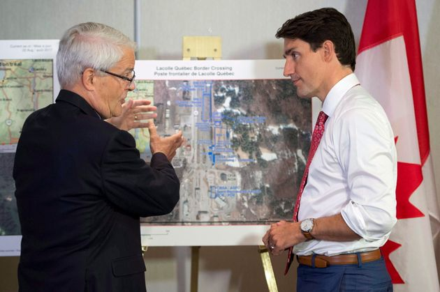 Prime Minister Justin Trudeau is briefed on the refugee installations at the...