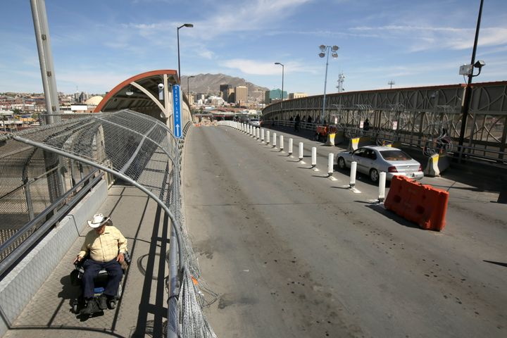 A man crosses from El Paso, Texas, into Mexico at Paso del Norte international border crossing bridge on April 9, 2019. The t