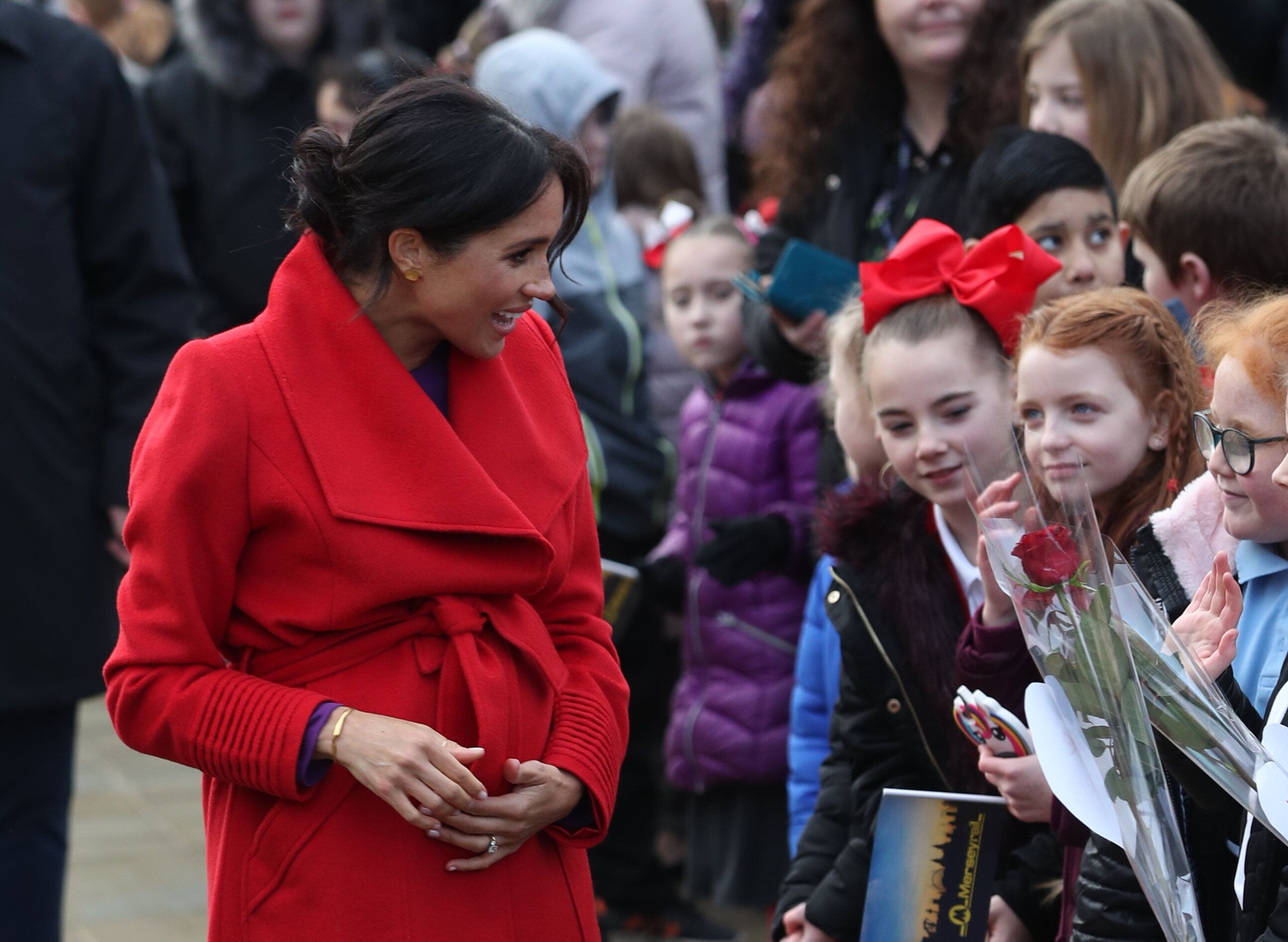 The Duchess of Sussex wearing Bar Jewellery's 'Wide Ripple Bracelet' in Birkenhead in January 2019 [Photo: PA]