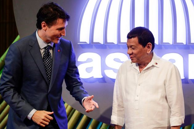 Prime Minister Justin Trudeau talks to Philippine President Rodrigo Duterte before...