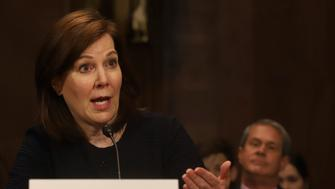 Wendy Vitter, President Donald Trump's nominee to be a District Court Judge for the Eastern District of Louisiana, gives testimony during a U. S. Senate Judiciary Committee Hearing on Capitol Hill in Washington on Wednesday, April 11, 2018. At right, listening, is her husband, former Senator David Vitter. (AP Photo/Harry Hamburg)