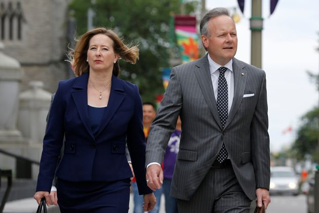 Bank of Canada Governor Stephen Poloz (r) and Senior Deputy Governor Carolyn Wilkins walk to a news conference...
