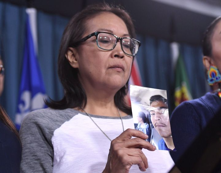 Debbie Baptiste, mother of Colten Boushie, holds a photo of her son during a press conference on Parliament Hill in Ottawa on Feb. 14, 2018.