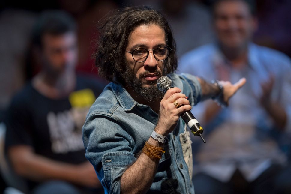 Jean Wyllys speaks during a rally of Brazilian leftist parties at Circo Voador in Rio de Janeiro on April...