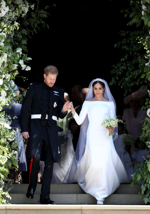 Harry and Meghan descend the steps on their wedding day on May 19,