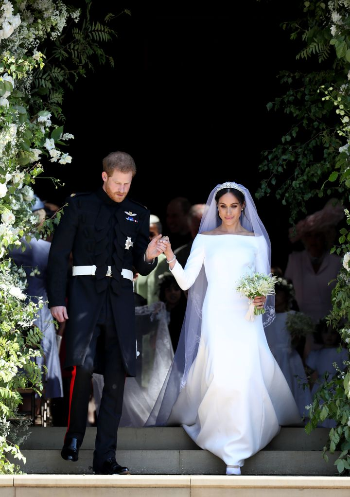 Harry and Meghan descend the steps on their wedding day on May 19, 2018.