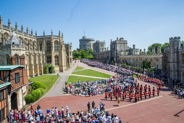 Crowds gathered in front of Windsor Castle to watch the royal wedding on May 19,