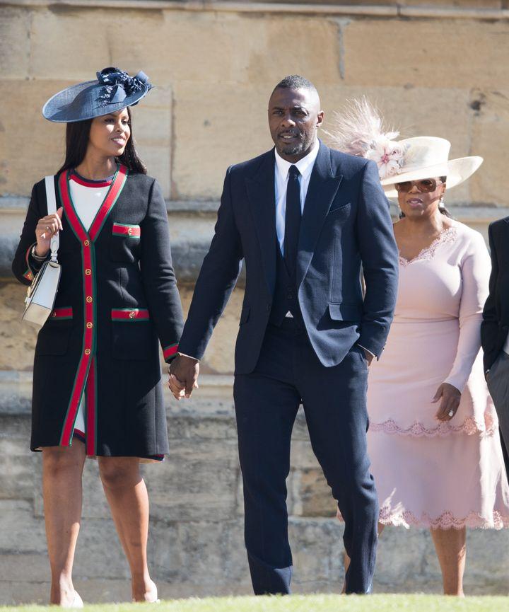 Sabrina Dhowre, Idris Elba and Oprah Winfrey attend the royal wedding.