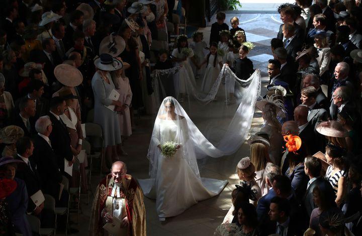 Meghan walks down the aisle on her wedding day.