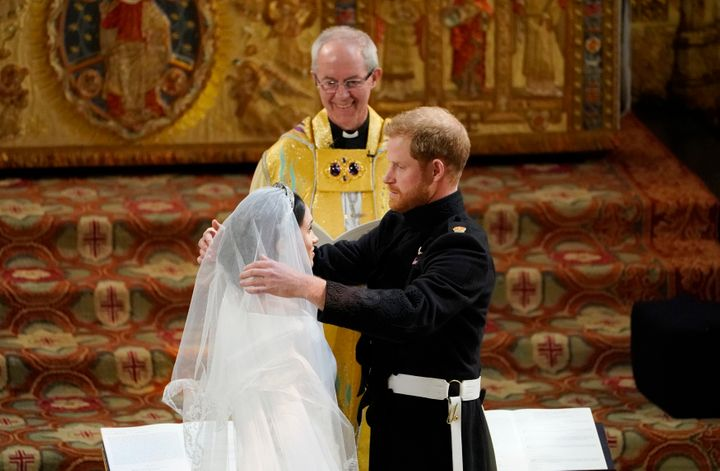 The archbishop of Canterbury Justin Welby declares Harry and Meghan husband and wife.