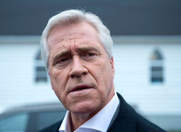 Liberal Leader Dwight Ball talks with reporters after voting in the provincial election at Immaculate...