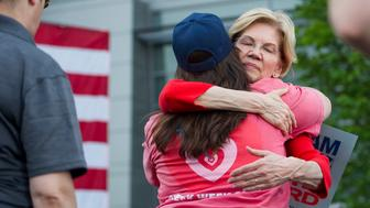 Democratic presidential candidate Sen. Elizabeth Warren, D-Mass., hugs a supporter after addressing a campaign rally at George Mason University in Fairfax, Va., Thursday, May 16, 2019. (AP Photo/Cliff Owen)