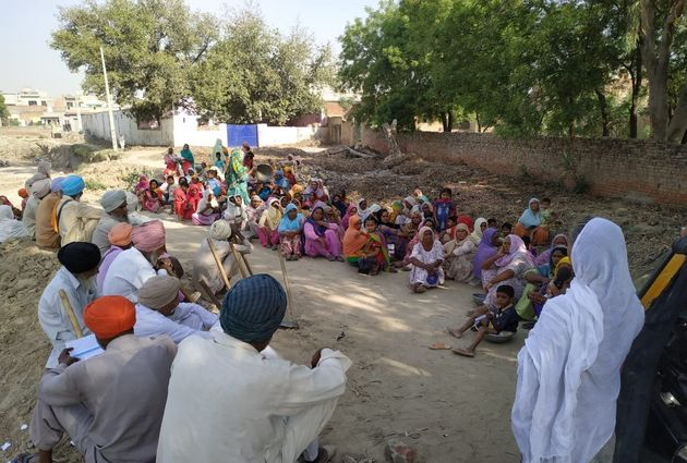 Candidate Veer Pal Kaur campaigning in a village at