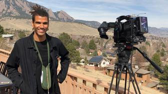 In this undated photo provided by lawyer Siddhartha Rathod, Zayd Atkinson poses for a photo. Atkinson was picking up trash outside his dormitory when a white police officer in Boulder, Colo., detained him in March, 2019. The officer, John Smyly, resigned this week under an agreement with city officials who found he had violated department policies. (Siddhartha Rathod via AP)